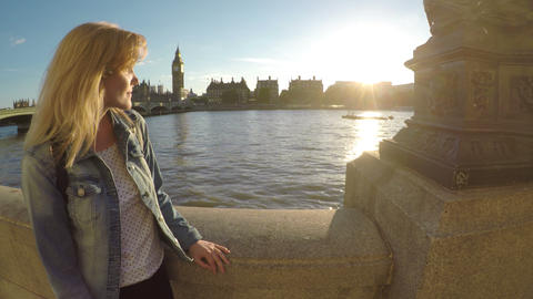 Young tourist woman admiring the Thames river and british landmarks in Live Action