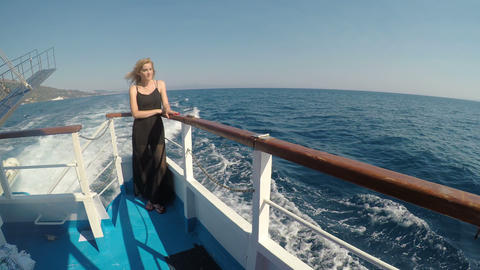 Peaceful beautiful woman in summer vacation sailing in cruise boat watching the Footage