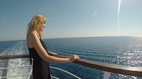 Relaxed woman enjoying her summer trip on yacht boat watching the seascape Footage