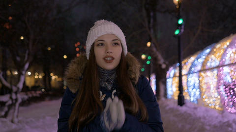 The girl warms her hands with her breath. In winter it is very cold Footage