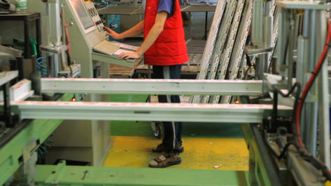 Workers in workshop. Line production of plastic windows Footage