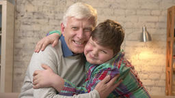 Grandfather and grandson embrace. Young fat boy and elderly grandfather. Happy Footage