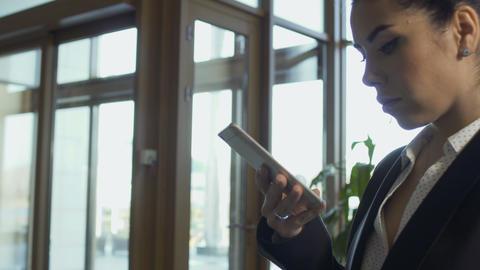 Stylish businesswoman uses phone Footage