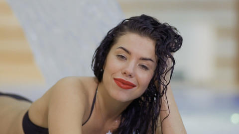 Beautiful woman with wet hair flirts with camera Footage