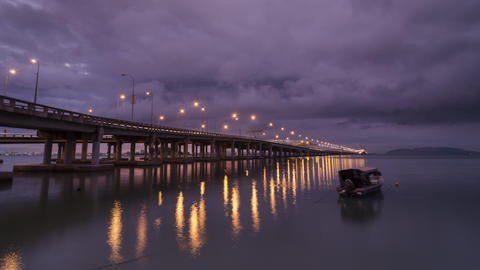 Timelapse Raining morning at the Penang bridge with a traditional boat 영상물