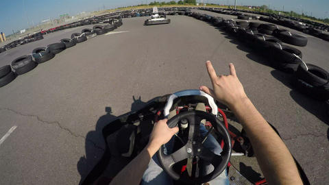 22Man drives go kart on track very fast, filmed from the driver's view, man hold 影片素材