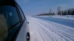 Car is driving on a winter road in the cold sunny day Footage