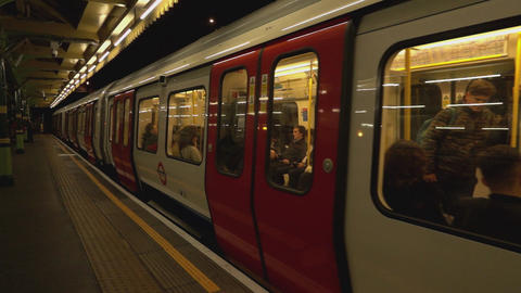 Departing train at London underground station - LONDON, ENGLAND Live Action