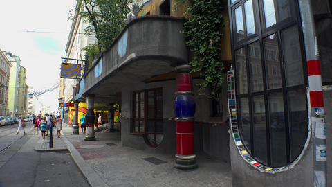 The colorful facade of the Hundertwasser house in Vienna. Austria. 4K Footage