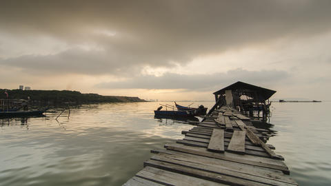 Timelapse beautiful sunrise with sun ray at fisherman wooden hut Footage