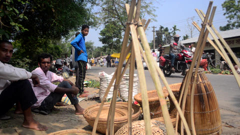 Slider shot of sellers who are selling Assamese bamboo equipment in India 영상물