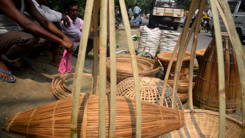 Slider shot of bamboo equipment selling in a suburban market in Assam Image