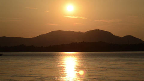 Pan shot of sunset at the bank of river Brahmaputra Footage