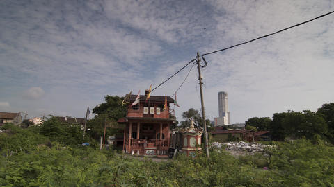 Timelapse Local traditional chinese temple nearby KOMTAR buildin Footage