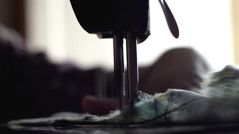 Close shot of sewing machine and moving cloth Footage