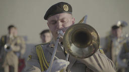 Trumpeter of a military band plays on a trumpet Footage
