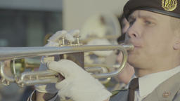 A man plays music on a trumpet in a military band Footage