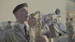 The soldier plays the saxophone in the military band Footage