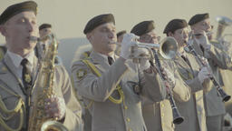 Members of the military orchestra play on the trumpet and saxophone Footage