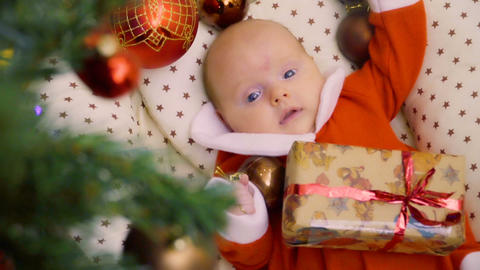 Cute two-month baby girl celebrates her first Christmas Footage