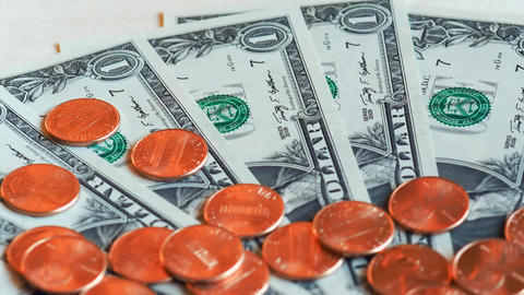 Zoom on Dollar (USD) notes and coins, United States (USA) Stock Video Footage