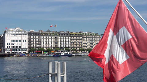 GENEVA, SWITZERLAND - JULY 06, 2017: Geneva, Geneva Lake and Swiss flag Footage