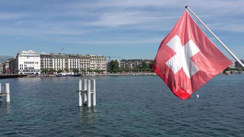 GENEVA, SWITZERLAND - JULY 06, 2017: Geneva, Geneva Lake and Swiss flag Footage