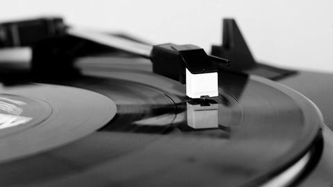 Vinyl record spinning in black and white Live Action