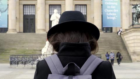 Woman Girl in black looking at Gendarmenmarkt market on the center of Berlin Footage