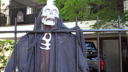 USA Virginia Norfolk ghostly skeleton behind iron fence Footage