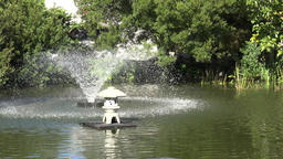 USA Virginia Norfolk swirl fountain in green pond of a small park Footage