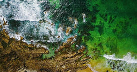 Aerial Ocean Waves Crushing On Rocky Beach Landscape Footage