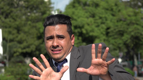 C0040 fearful hispanic business man Stock Video Footage