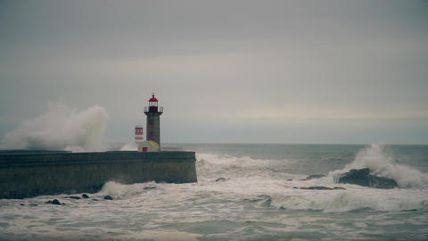 Storm on the Atlantic coast near the old lighthouse, Porto, Portugal Footage