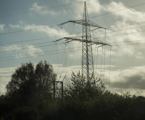 View of electricity poles next to the highway Photo