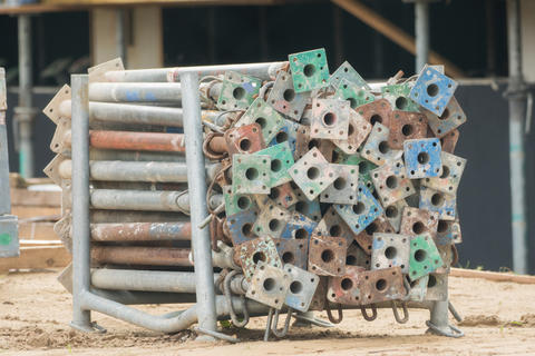 Stacked material on the construction site フォト