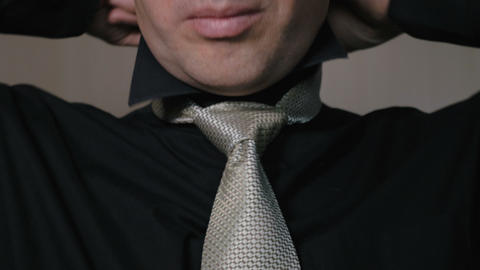 The man straightens the knot of his tie. Businessman going to work in the Image
