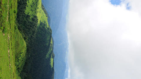 Vertical video. The shadows of the clouds in the mountains. Zoom. Time Lapse. Footage