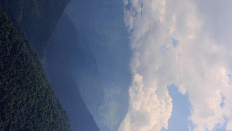 Vertical video. Clouds in the mountains. Zoom. Time Lapse. Sochi, Russia Footage