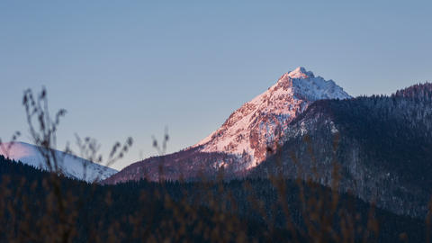 Morning sunlight colors in mountain peak at sunrise. Time lapse dolly shot Footage