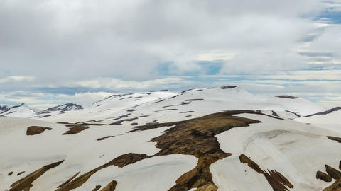 Clouds moving over snowy rainbow mountains in Iceland in Landmannalaugar. Time Footage