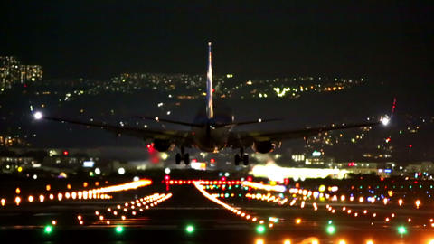 big plane landing during the blue hour GIF