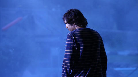 Rear view of Man at Resort Live Action
