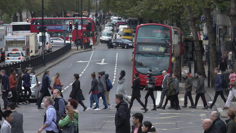 People crossing the street in London - LONDON, ENGLAND Live Action