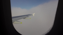 Airliner fly down inside clouds, window view. Blue sky change to cloud mass Live Action