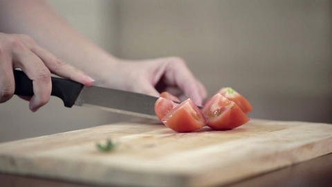 Close-up of professional Cook Chopping tomato on cutting board Live Action