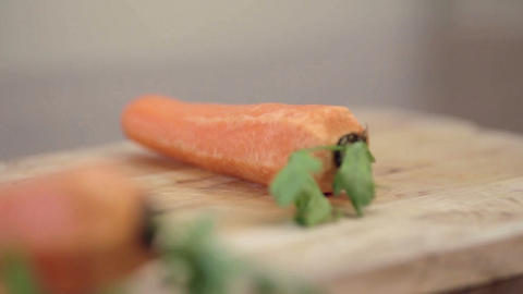 Close-up of professional cook chopping carrots on cutting... Stock Video Footage