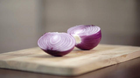 Close-up of professional cook chopping onion in half on... Stock Video Footage