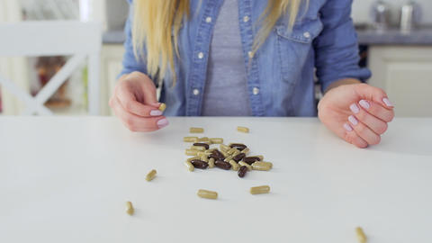 Young girl choose healthy eating and refuses from pills Footage