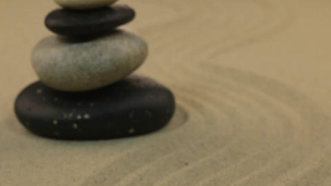 Approximation the pyramid made of stones standing on the sand zigzag. Dolly shot Live Action